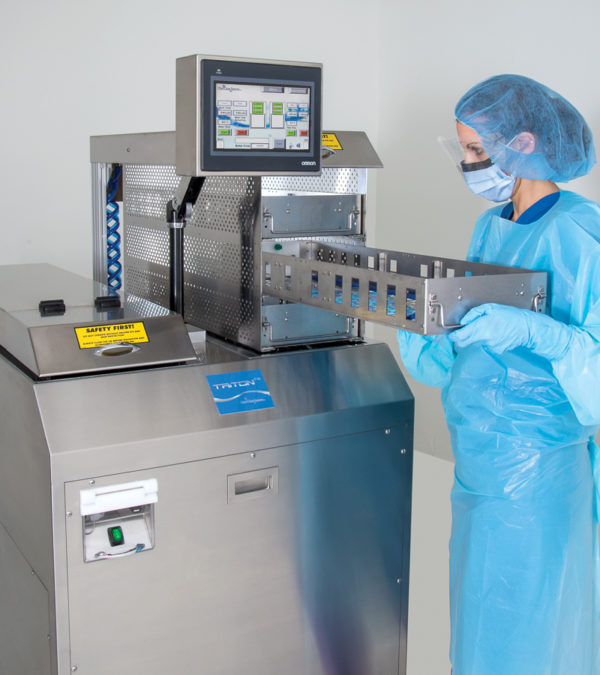 SPD technician places lumen tray in Triton 72 ultrasonic cleaning system