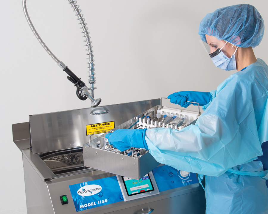 SPD technicial placing a tray in Model 1150 ultrasonic cleaning system